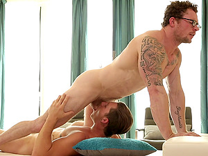 Gay lovers enjoy makin love on the hotel bed during vacation