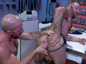 Teddy Bear and Nigel March just can't resist fucking in a sex shop