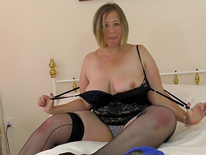Short haired blonde mature BBW strips and masturbates at home
