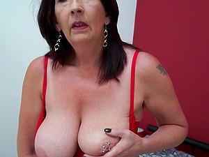 Brunette amateur mature British MILF Katie Leigh masturbates at home