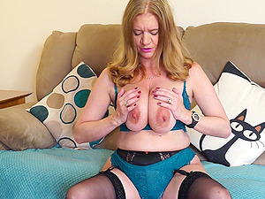 Busty blonde mature amateur British MILF Lily May exposes her pussy