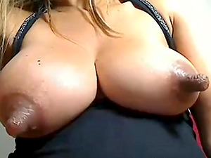Beautiful blonde shows her natural juicy tits with lactating nips