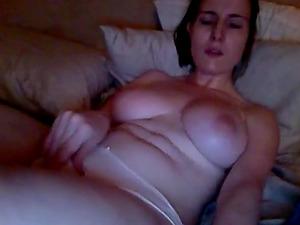 Horny girlfriend watching porn and masturbating