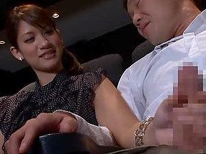 Beautiful Kotomi Nagisa gives a handjob in the cinema