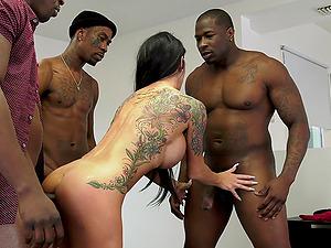 Tattooed MILF whore Melissa Lynn gangbanged by black dudes
