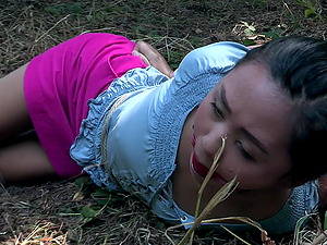 Cute Latina Elle Voneva tied up to a pole in the forest and abused