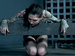 Nipple clamps on tattooed Rocky Emerson while being tied up and abused