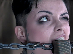 Tattooed punk slut Leigh Raven pussy abused while tied up and gagged