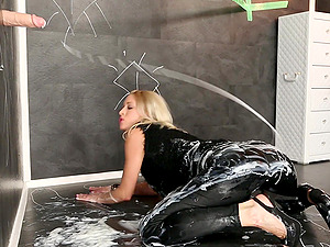 Blonde elegant slut gets messy with a fake glory hole cock and cream