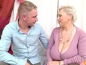 Busty short haired mature BBW pounded doggy style by a younger dude