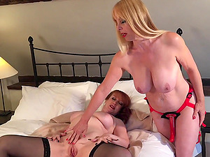 Red fucked by her girlfriends strap on