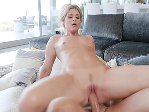 Blonde MILF grabs balls with feet while riding a big fat cock