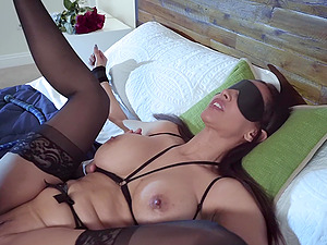 Mature Latina babe Isis Love sprayed with cum after a kinky session