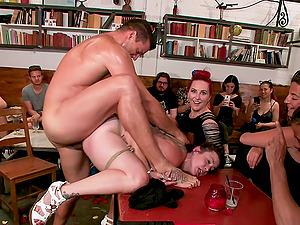 Mz Berlin and Bella Rossi in a kinky bondage public humiliation scene