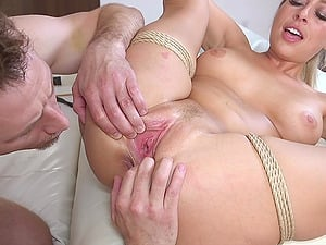 Buxom blonde MILF Zoey Monroe doggy fucked while all tied up