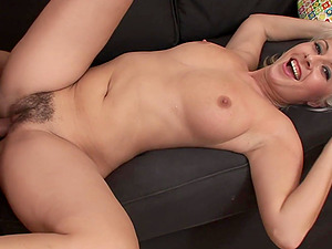 Mature busty blonde Daria Glower pussy licked and fucked on the couch
