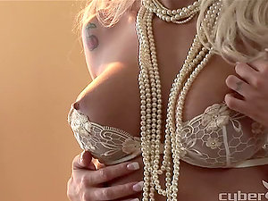 Stephanie Olson poses for the web cam in a pearl necklace