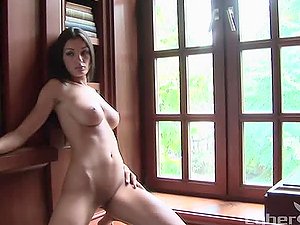 Provocative stunner Jo Garcia gets naked in the library