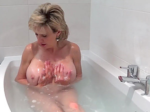 Lady Sonia takes a bath then rubs her pussy