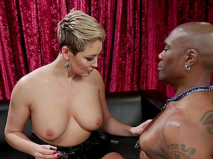 Dominant blonde MILF Ryan Keely pegs a black dude with a strap on