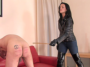 Dominant babe in leather boots The Hunteress spanks her male slave