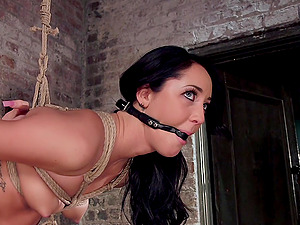 Tied brunette Sabrina Banks is more than ready for unforgettable sex