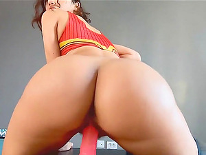 Horny babe rides a big dildo on cam and enjoying it