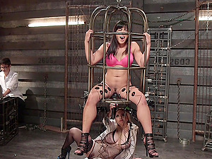Torture dungeon sex with a strapon with Aiden Starr and Mia Little