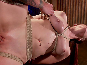 Bella Rossi enjoys the BDSM sex games on the floor while she is tied