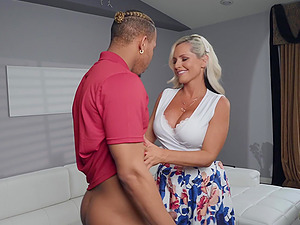 Alena Croft gets fucked by a stiff cock on the couch while she moans