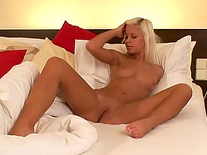 Kristi N. masturbates on the bed using her fingers and imagination