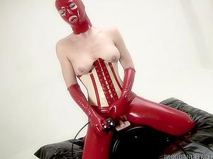 Madame Adore wears sexy costume for masturbating with a dildo