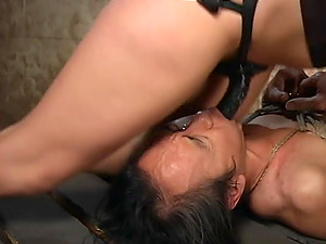 Pretty blonde Harmony gives a blowjob to a dude during the BDSM