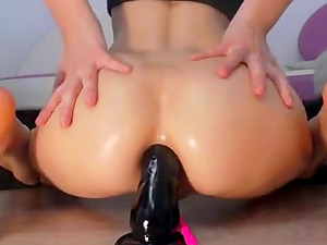 Horny girl rides a fat dildo deep in her tiny asshole