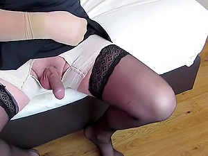 sissy crossdresser cumming in girdle and upskirt dress