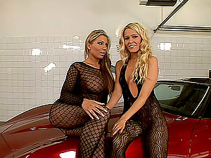 Hot Lezzies In Fishnet On Top Of A Car