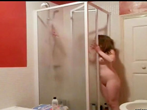 I spy on my girlfriend when she takes a shower. I jerk off while watching her.