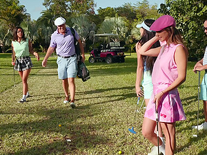 Golf players Jade Amber and Adria Rae playing with a large pole
