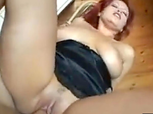 Sultry redhead milf with giant juggs and booty and chunky trimmed snatch