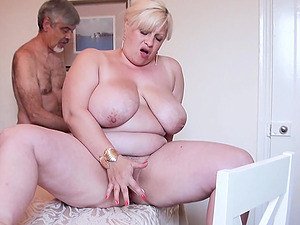 Horny friend is playing with hairy mature pussy of busty blonde