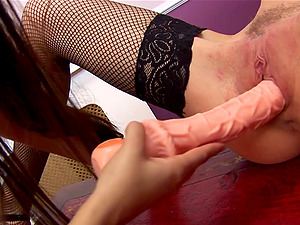 Natural tits Claudia Rossi and Cypress Isles playing with a dildo