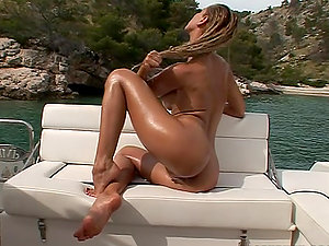 Sandy fucks her vagina with a fucktoy near a beautiful pond