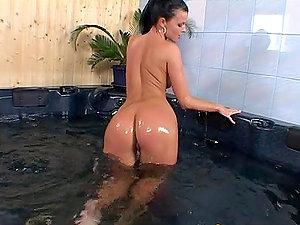 Slender Juditta poses naked in Jacuzzi and masturbates