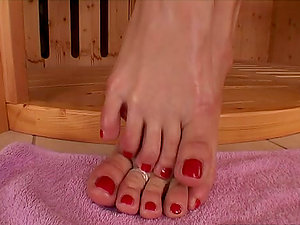 Adriana Malkova the hot blonde shows her feet in a sauna