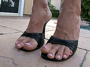 Hot Whore Shows Off Her Feet By The Pool