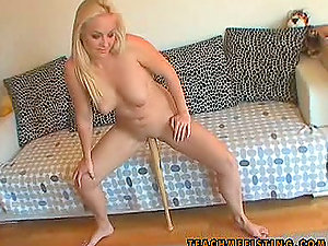 Blonde Inserts a Baseball Bat in Her Vulva