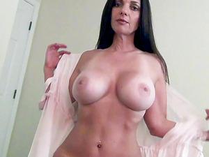Big fake hooters mature Mindi Mink loves to flash and seduce