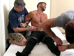 Brutal tickling with with a stud tied up to a bed and two perverts
