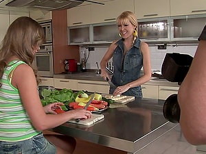 Old school Girl/girl scene in the kitchen with cucumbers