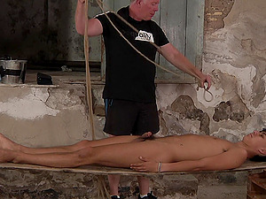 HD video of torture session between an older guy and a younger man